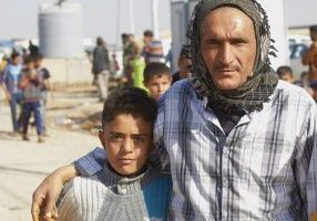 iraq man with young boy